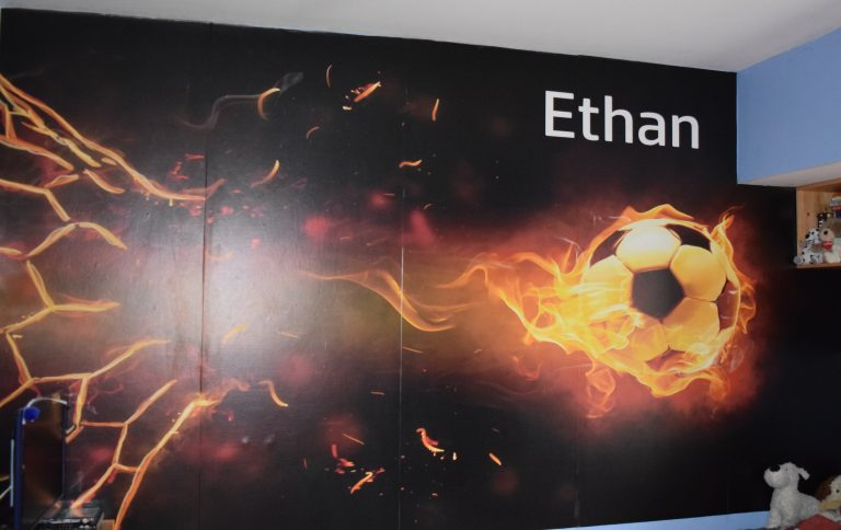 Celebrate success with burning football on Ethan's wall